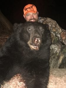 Francis Darr with his bear harvest